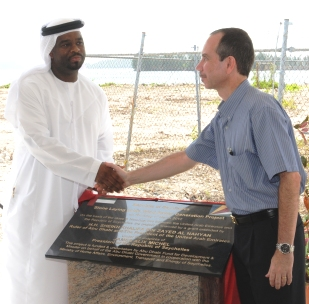 Shaking hands after unveiling the plaque to mark the official launch of the project