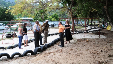 The team at the Anse Aux Pins playground discussing renovation work to be done on Saturday