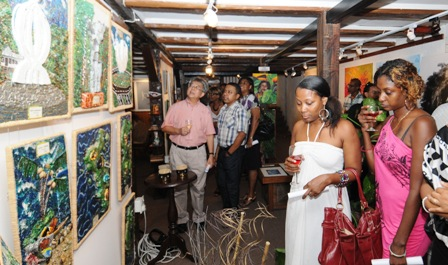 Guests viewing the exhibition after its launch