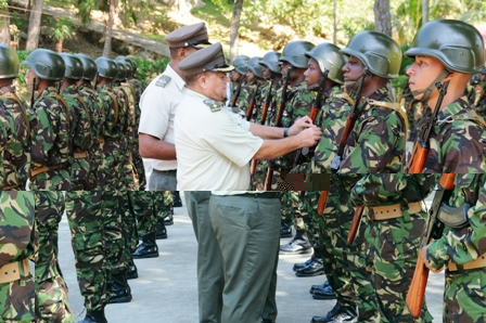 Chief of staff Colonel Clifford Roseline commissioning one of the recruits