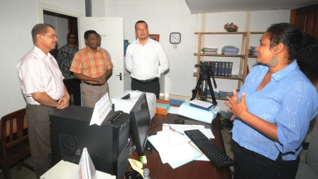 President Michel and Vice-President Faure talking to a member of staff in the presence of Attorney-General Ronny Govinden