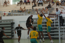 Premium Spikers' Jude Frederick (number ...) finds a way past Beau Vallon's two-man block