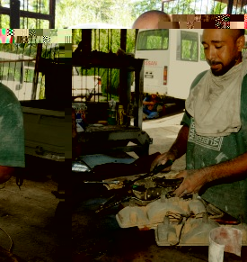 A mechanic in his workshop at Grand Anse