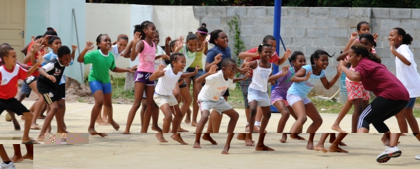 Children learning to keep fit with fitness instructor Dorothy Isidore