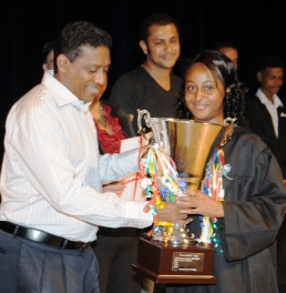 Rachel Ernesta receiving the President's Cup from Vice-President Faure