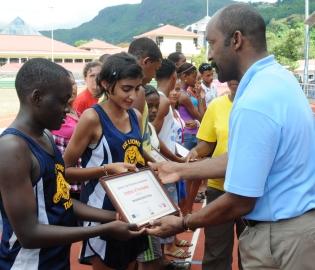Mr Meriton presenting certificates to athletes from the International School of Kenya