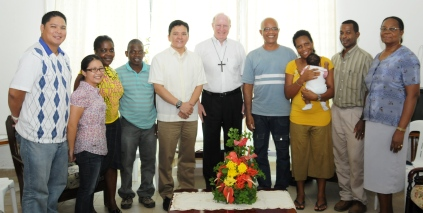 """Father Joel and his delegation in a souvenir photograph with Bishop Wiehe and other couples of the movement""""Couples for Christ"""""""