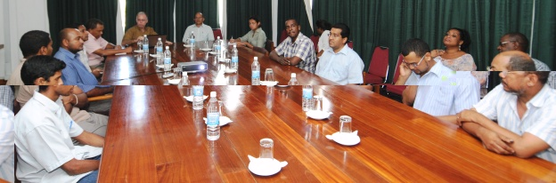 Dr Payet in a meeting with management staff of the company