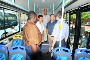 Guests viewing the interior of one of the new buses