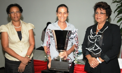 Mrs Hermitte, flanked by Minister Mondon (right) and education principal secretary Merida Delcy, at the award presentation ceremony on Monday