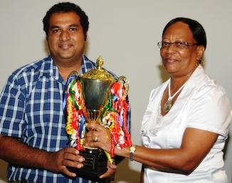 Plaisance primary head teacher Cyril Pillay accepts the special award on behalf of his school