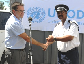 Chief superintendent Cecile accepts the keys to the vehicles from Mr Forbes