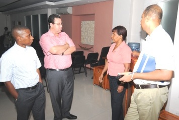 The delegation in discussion with CEO Crea during the visit at the National Tender Board