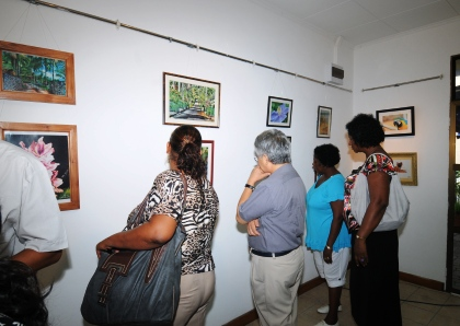 Guests viewing the photos on display after the official launch