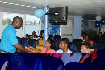 Passengers being served snacks and drinks upon boarding for the afternoon trip to Praslin