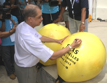 President Michel signing the two buoys previously attached to the fore end of the cable