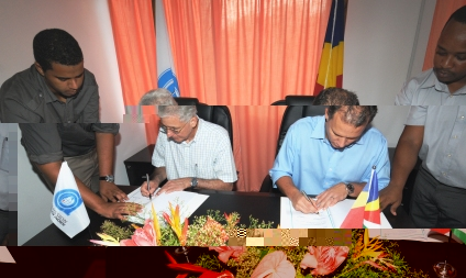 Mr D'Offay (left) and Minister Adam signing the MoU