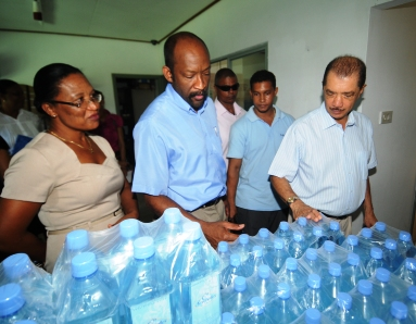 Inspecting the bottled water products of a small enterprise at Port Glaud