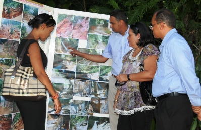 Viewing the exhibition at the site which shows restoration work done after the landslide