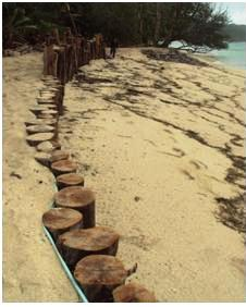 Anse Royale coastal protection project involving timber piling, rock beaching and notched groynes