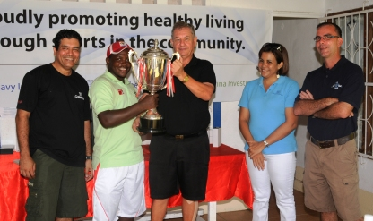 Winner Jean-Baptiste receives his cup from captain Guy Adam as club captain Rizvi (left), Mrs Lebon and Mr Morin look on