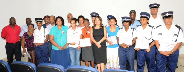 The certificate recipients in a souvenir photograph with guests