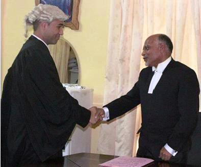 Mr Robert shakes hands with Justice Karunakaran after the swearing in ceremony