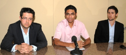 Mr Choppy, flanked by the two experts, during the press conference