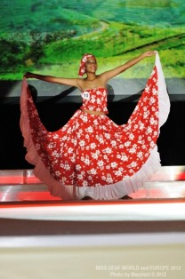 Monica performing the sega dance at the pageant's crowning ceremony