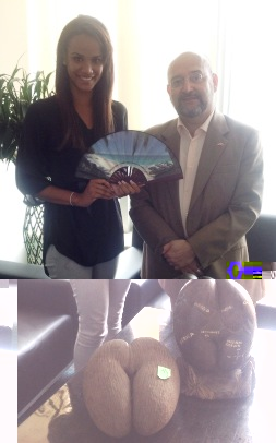 Miss Seychelles Sherlyn Furneau holds one of the fans in the presence of Ambassador Le Gall