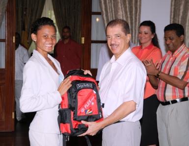 President Michel accepts the kit from Lissa Labiche