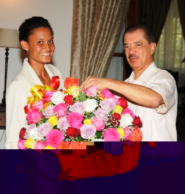 President Michel presenting Labiche with her basket of flowers
