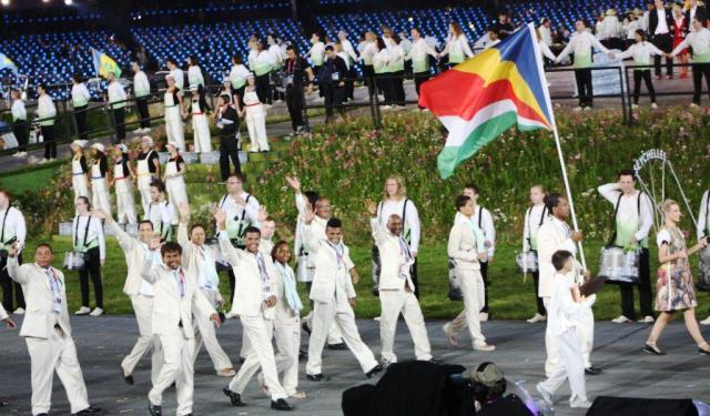 Flagbearer Dugasse leads Team Seychelles during the parade on nations inside the Olympic Stadium