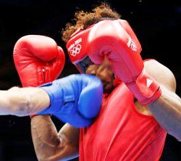 Allisop (right) feels the full force of Bhagwan's punch