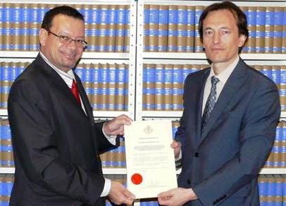 Ambassador Jumeau (left) hands over Seychelles instrument of ratification at the UN headquarters
