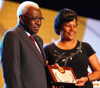 Receiving the IAAF plaque, as Africa' most deserving athlete