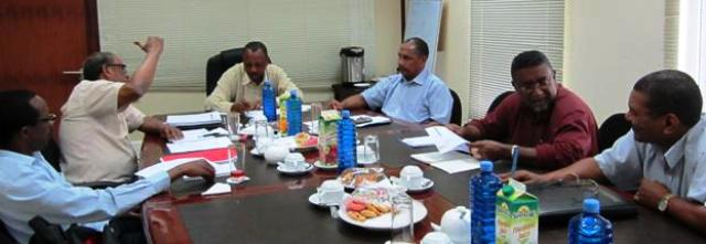 Minister Sinon chairing a meeting between the two-man delegation and top MNRI officials