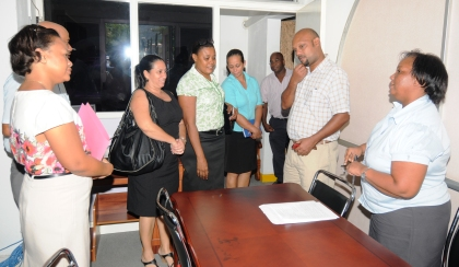 Some members of the media committee of the National Assembly meets Nisa's senior accountant Lynda Léon