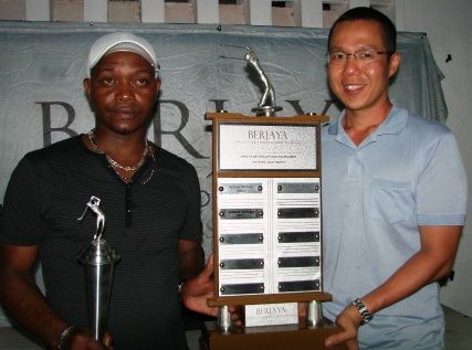 Winner Esther accepts the floating trophy from Mr Choo