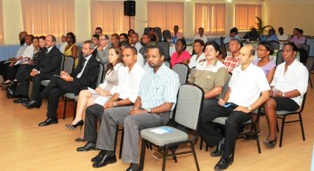 ...as delegates listen