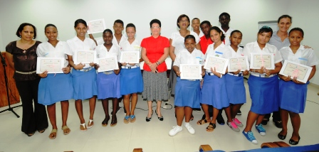The peer educators proudly show their certificates