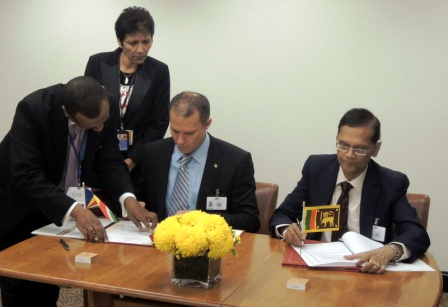 Minister Adam signing the agreements with the Mozambican (left) and Sri Lankan ministers