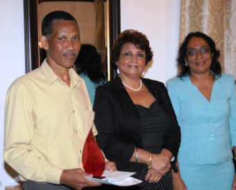 Longest serving teacher trainer Alex Souffe with Mrs Mondon and University of Seychelles vice-chancellor Marina Confait after getting his award