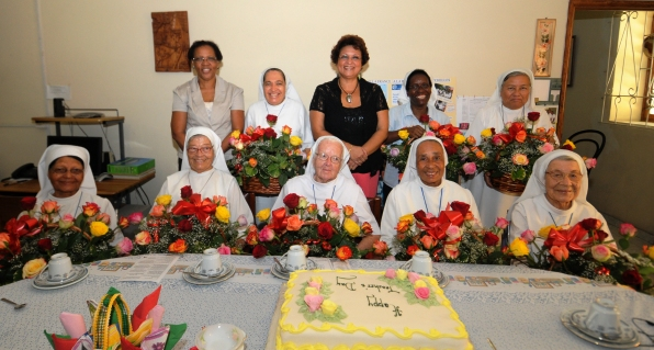Education officials and the nuns in a souvenir photograph