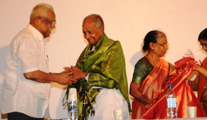 Master Siva (right) being honoured during the farewell gathering at Roche Caiman