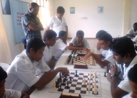 Young chesslers in action during the competition