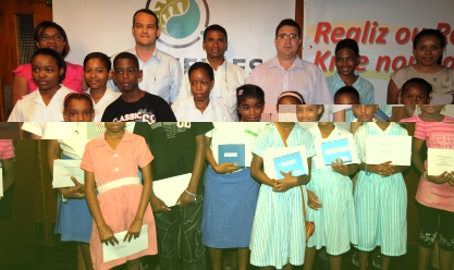 The winners in a souvenir photograph with guests at the prize-giving ceremony