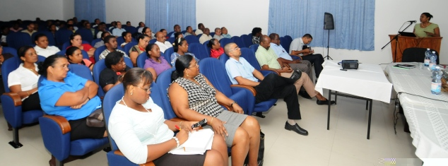 Guests and delegates listening to a presentation at yesterday's meeting