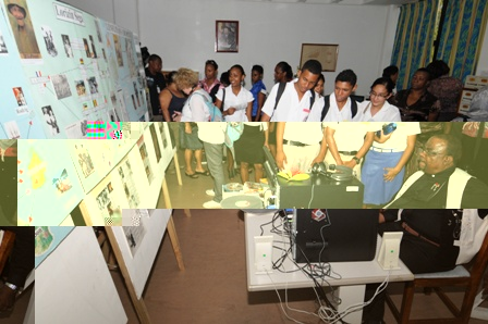 Guests viewing the exhibition depicting the various services the archives offer