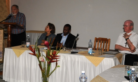 Mr Mancham (at podium) addressing delegates at the close of the symposium Tuesday
